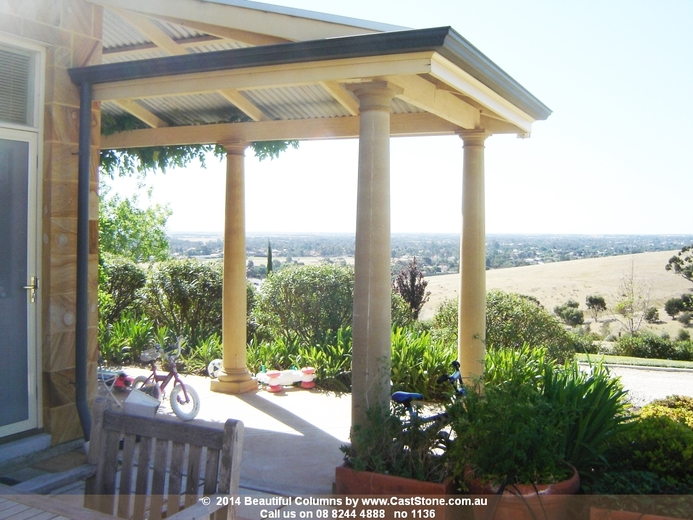 Veranda Sandstone Columns with Tuscan base, smooth column & Doric cap over looking a beautiful vista