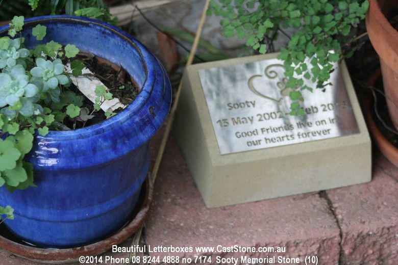 Beloved pet sandstone memorial stone in the garden