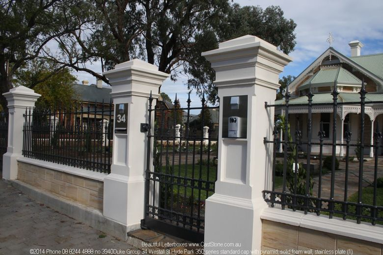 Grand Heritage pillars frame a century old home